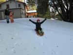 Eileen Truberman sledding in the snow