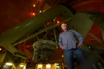 Music composer Larry Groupe stands under the dome of the 200-inch telescope operated by California Institute of Technology.  In late August Groupe will premiere a new piece for a string quartet which will be performed on the observatory floor of the Palom